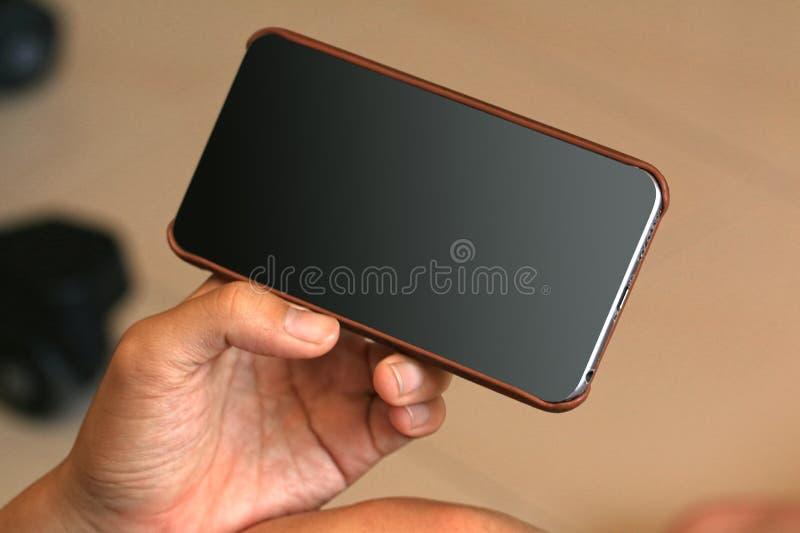 мобильный телефон используя стоковые изображения rf