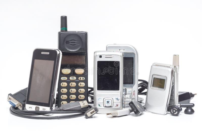 Мобильный телефон и аксессуар на белизне стоковые изображения