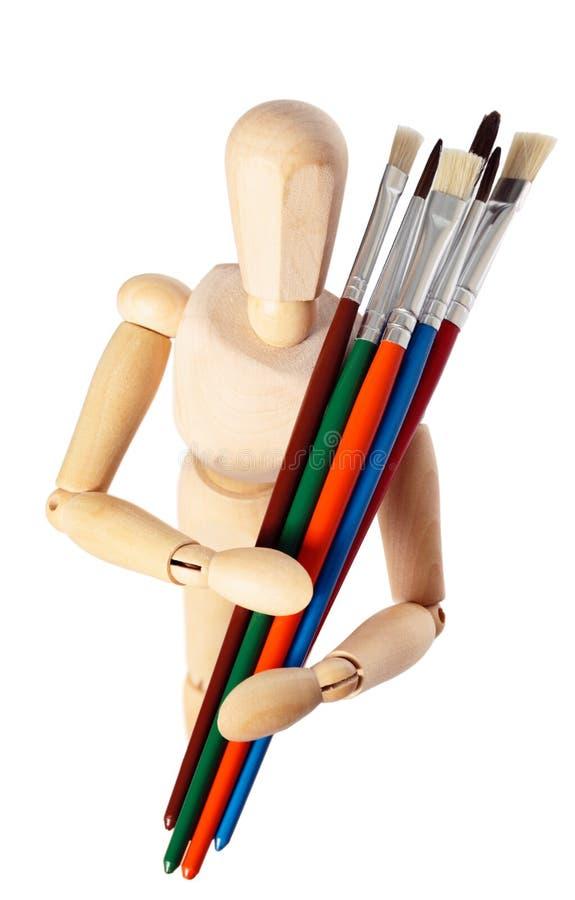 модельный колеривщик s paintbrushes деревянный стоковое фото