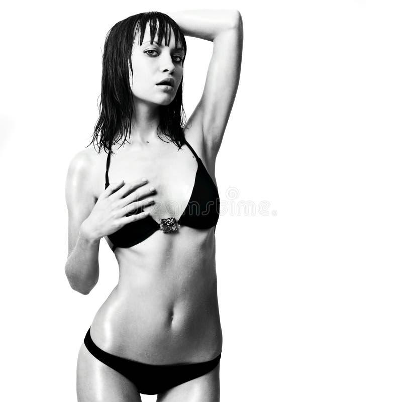 модные сексуальные детеныши женщины swimsuit стоковая фотография