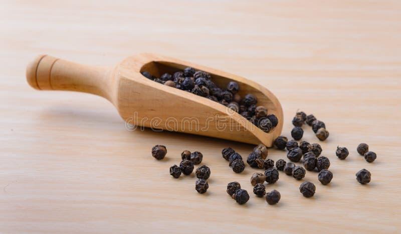 Мозоль перца на древесине стоковая фотография rf