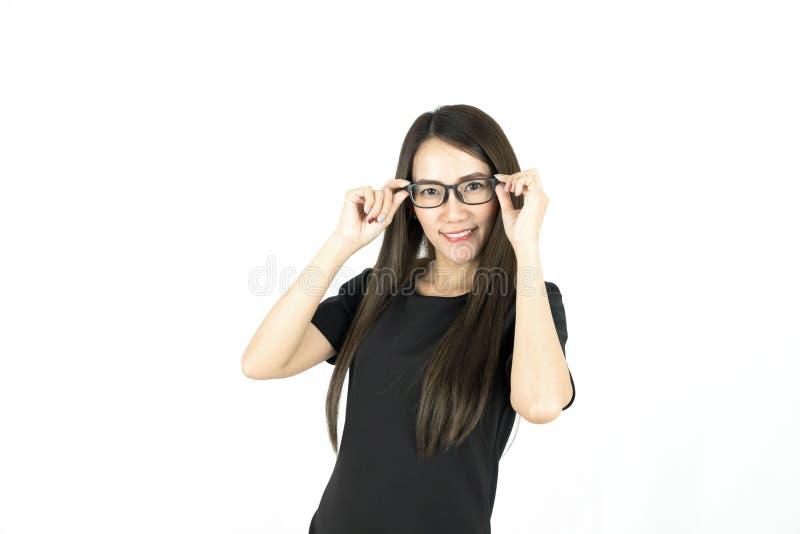 Молодая азиатская женщина с стеклами стороны smiley нося стоковые фотографии rf