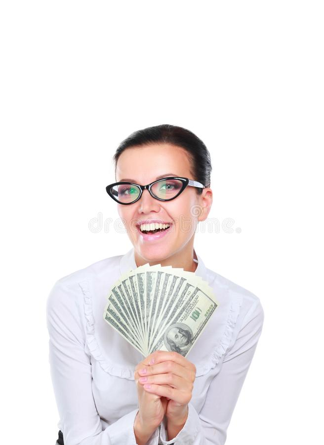 Молодая бизнес-леди держа положение денег на белой предпосылке стоковое изображение rf