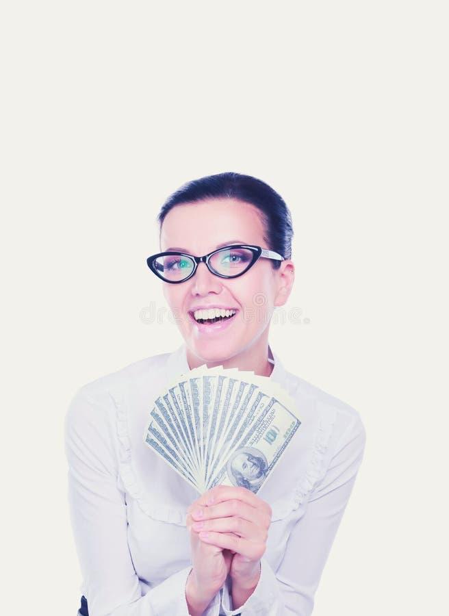 Молодая бизнес-леди держа положение денег на белой предпосылке стоковые фото