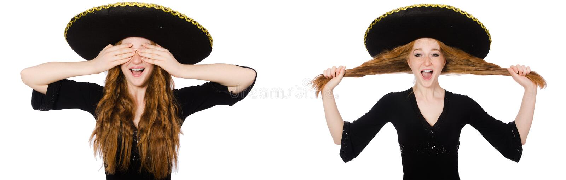 Молодая дама redhead в черном платье с черным sombrero стоковое фото