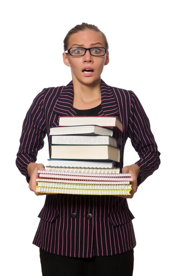 Молодая женщина в пурпурном костюме держа книги стоковые изображения rf