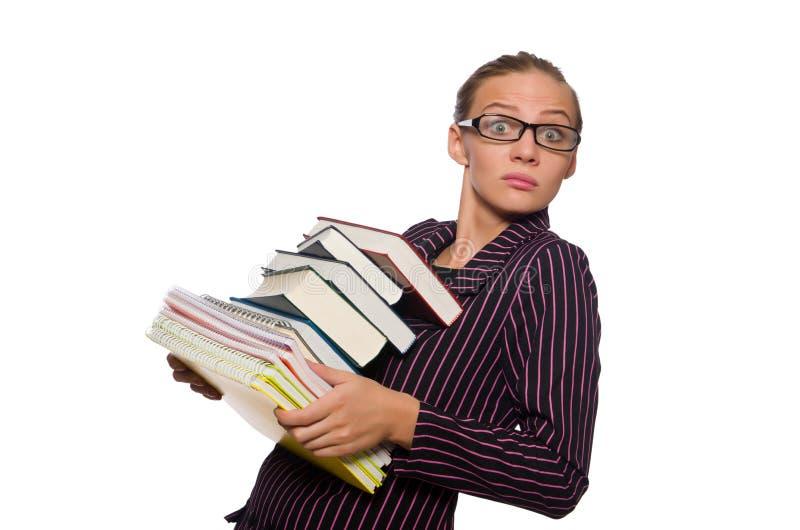 Молодая женщина в пурпурном костюме держа книги стоковая фотография rf
