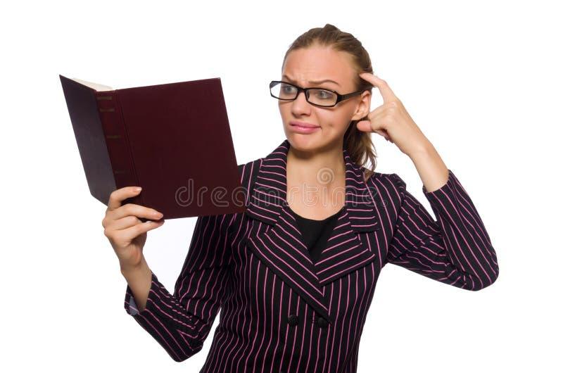 Молодая женщина в пурпурном костюме держа книги стоковое изображение