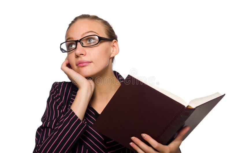 Молодая женщина в пурпурном костюме держа книги стоковое фото rf