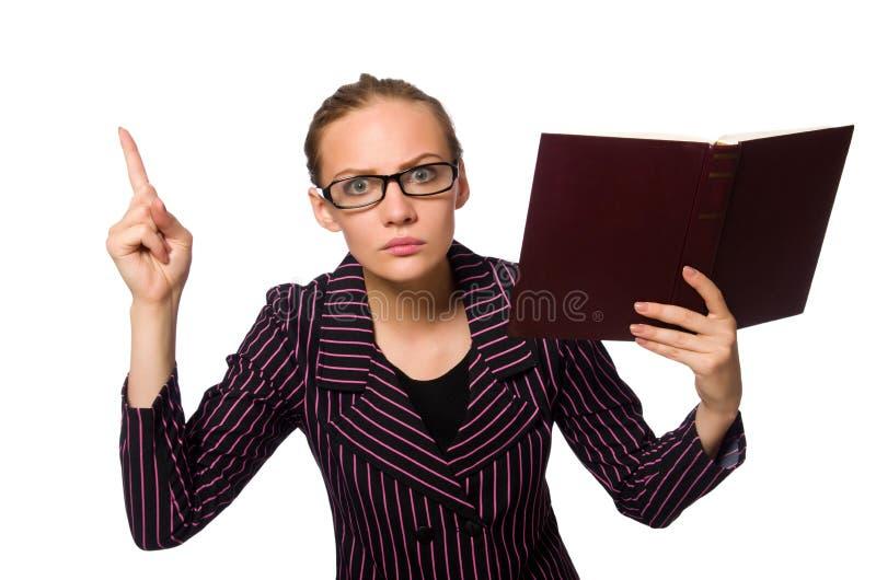 Молодая женщина в пурпурном костюме держа книги стоковое фото