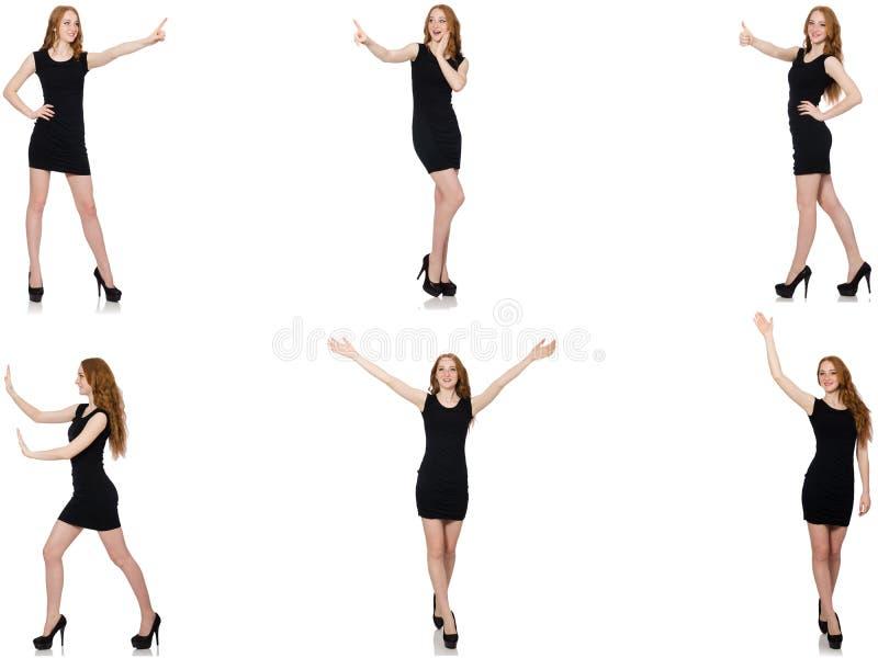 Молодая женщина в черном платье отжимая виртуальную кнопку стоковые изображения rf