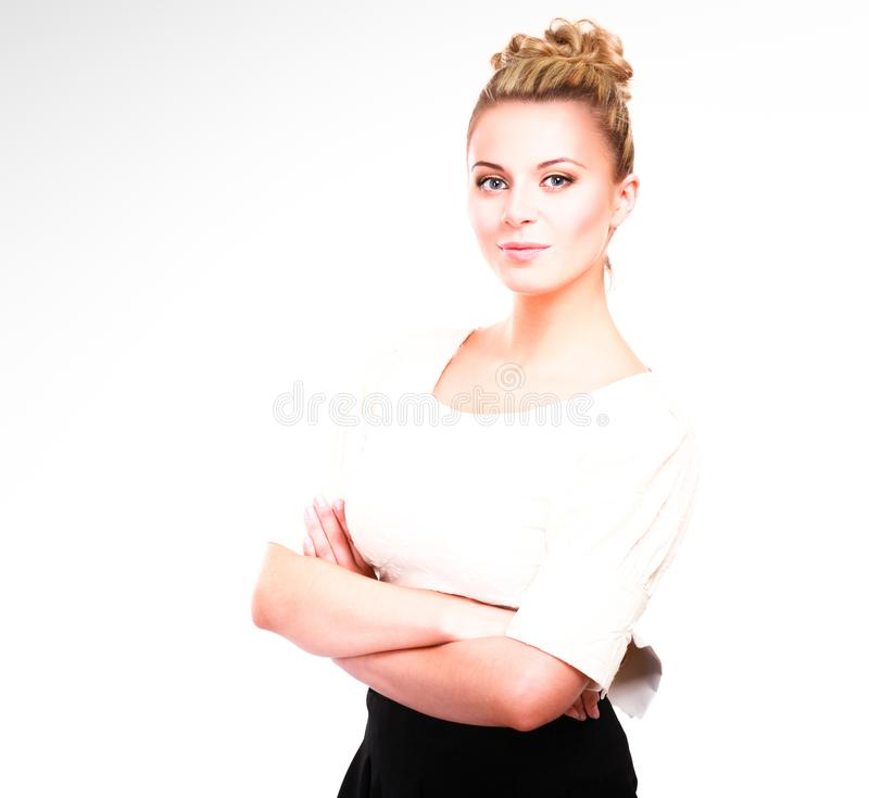 Молодая женщина стоя на белой предпосылке стоковое фото rf