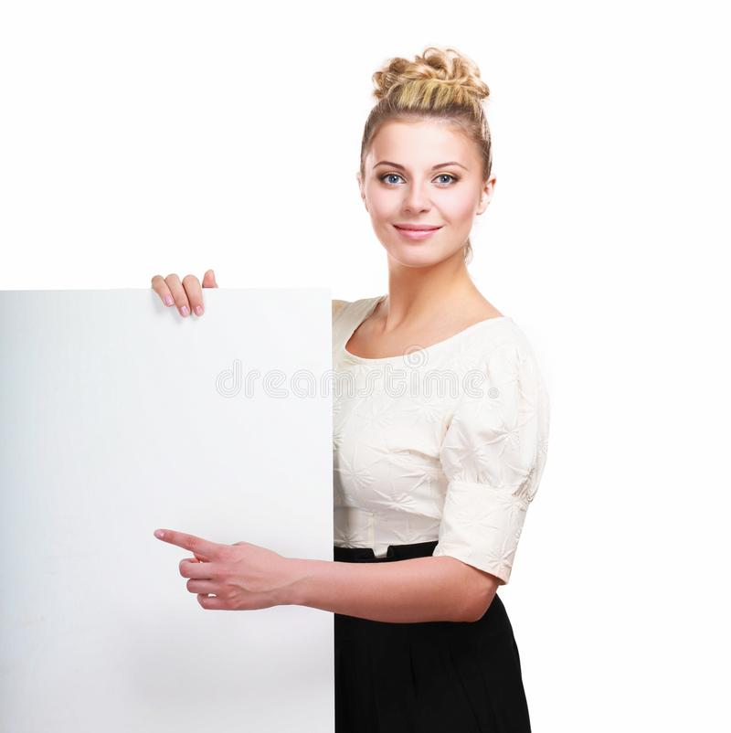 Молодая женщина стоя с пробелом на белой предпосылке стоковая фотография rf