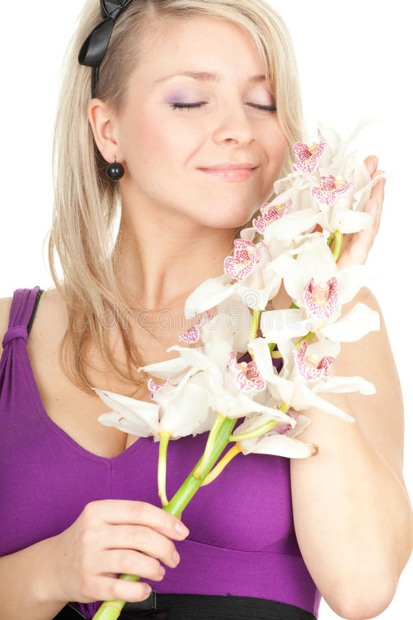 Молодая женщина с белой орхидеей стоковая фотография