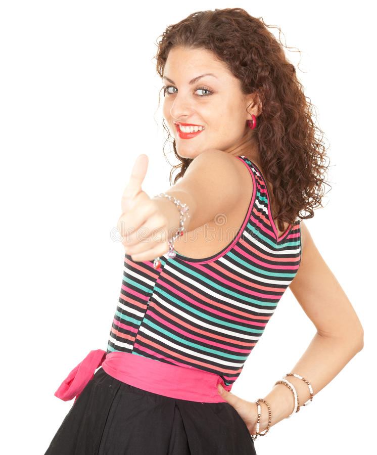 Молодая женщина с большим пальцем руки вверх стоковое фото