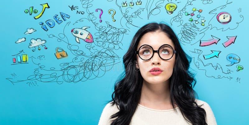 Молодая женщина с много мыслей стоковые изображения