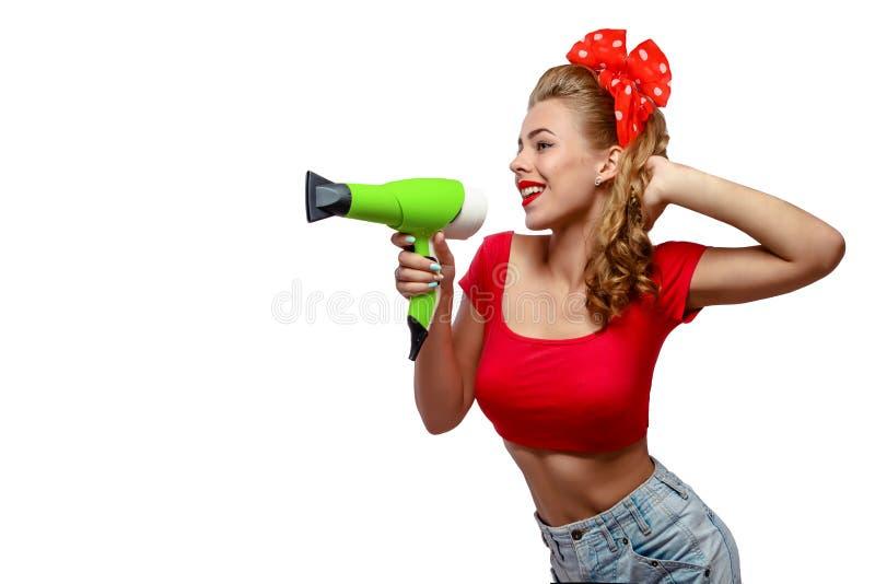 Молодая женщина с феном для волос стоковое изображение rf