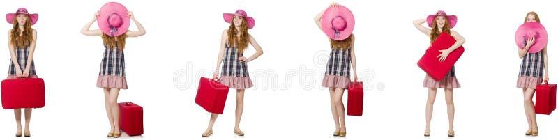 Молодая женщина с чемоданом изолированным на белизне стоковая фотография rf