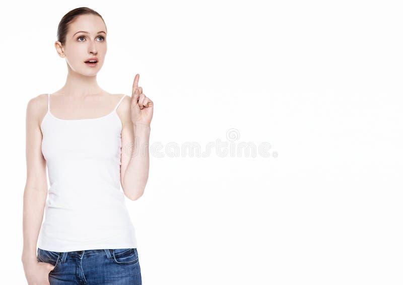 Молодая красивая женщина имея сюрприз идеи белый стоковое изображение rf