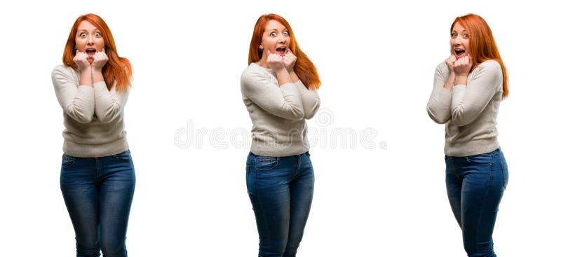 Молодая красивая женщина redhead над белой предпосылкой стоковая фотография