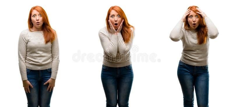 Молодая красивая женщина redhead над белой предпосылкой стоковое фото