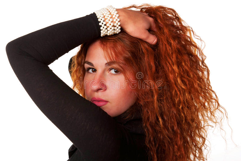 Молодая красивейшая red-haired женщина стоковое фото