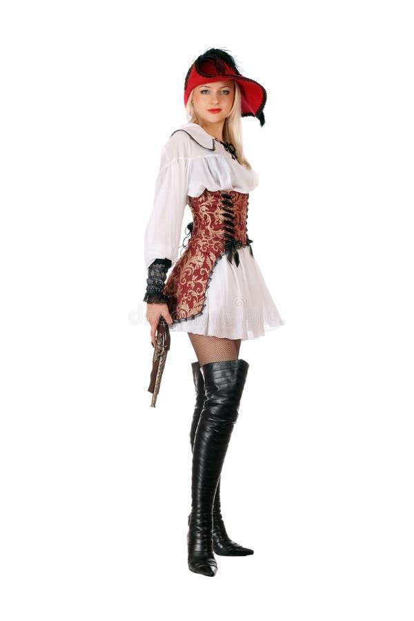 Молодая привлекательная блондинка с пушкой стоковая фотография