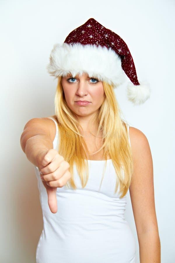 Молодая разочарованная женщина рождества стоковое изображение rf