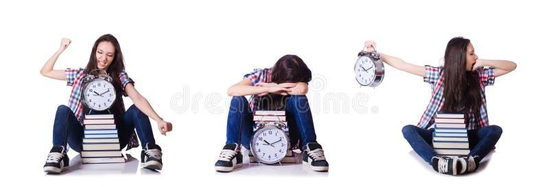 Молодая студентка пропуская ее крайние сроки на белизне стоковое изображение rf