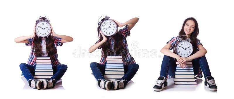 Молодая студентка пропуская ее крайние сроки на белизне стоковое изображение