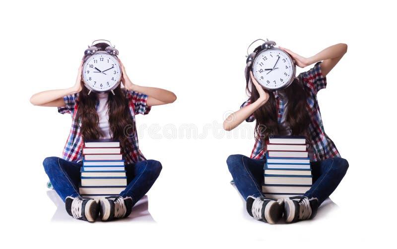 Молодая студентка пропуская ее крайние сроки на белизне стоковое фото rf