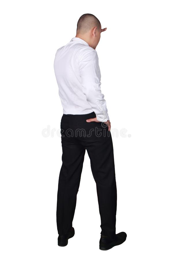 Молодой азиатский бизнесмен выглядя передним жестом, видом сзади стоковое фото