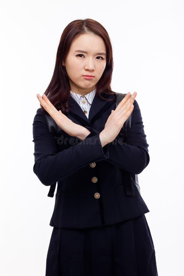 Молодой азиатский знак выставки x студента стоковое изображение