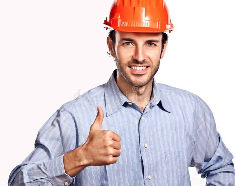 Молодой архитектор думает позитв изолированный на белизне. стоковая фотография rf