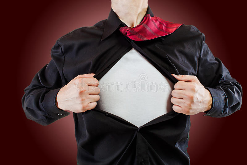 Молодой бизнесмен показывая костюм супергероя стоковые фотографии rf