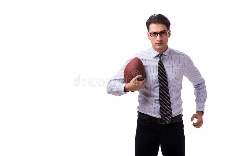 Молодой бизнесмен с американским футболом изолированный на белизне стоковые фото