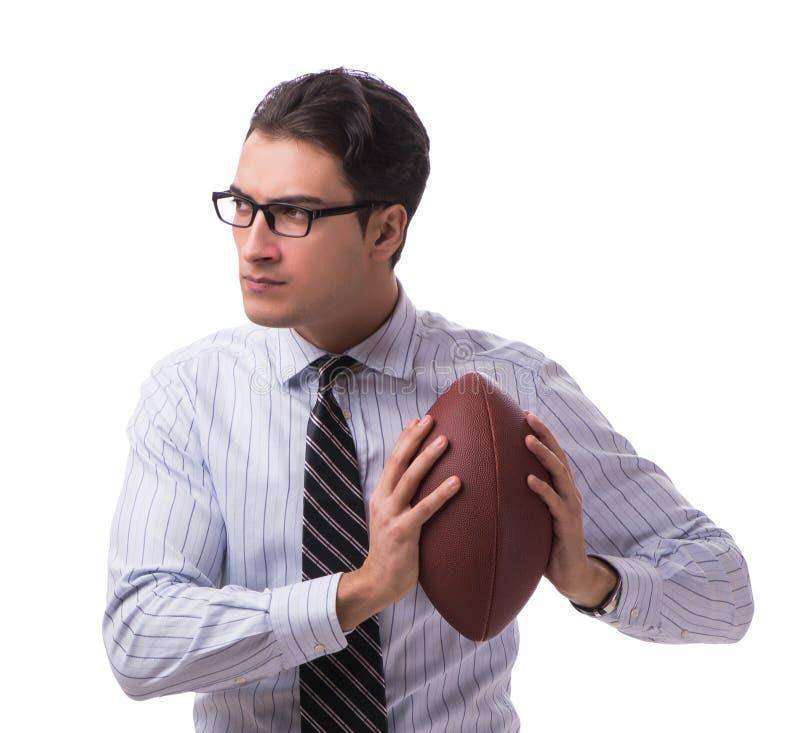 Молодой бизнесмен с американским футболом изолированный на белизне стоковая фотография rf