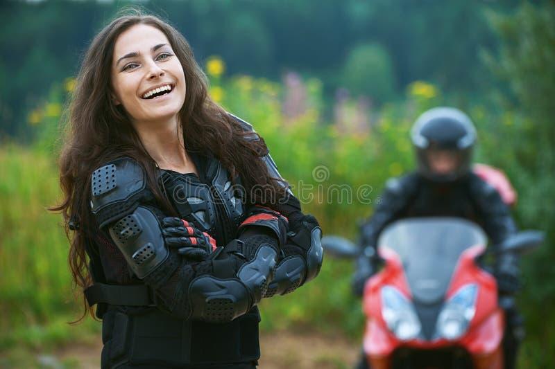 Молодой женский motorcyclist стоковые фотографии rf