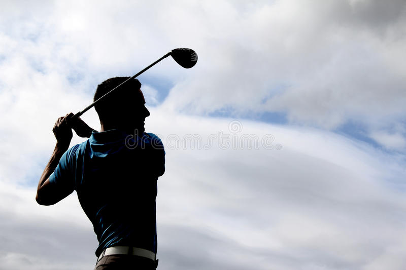 Молодой игрок в гольф стоковые изображения