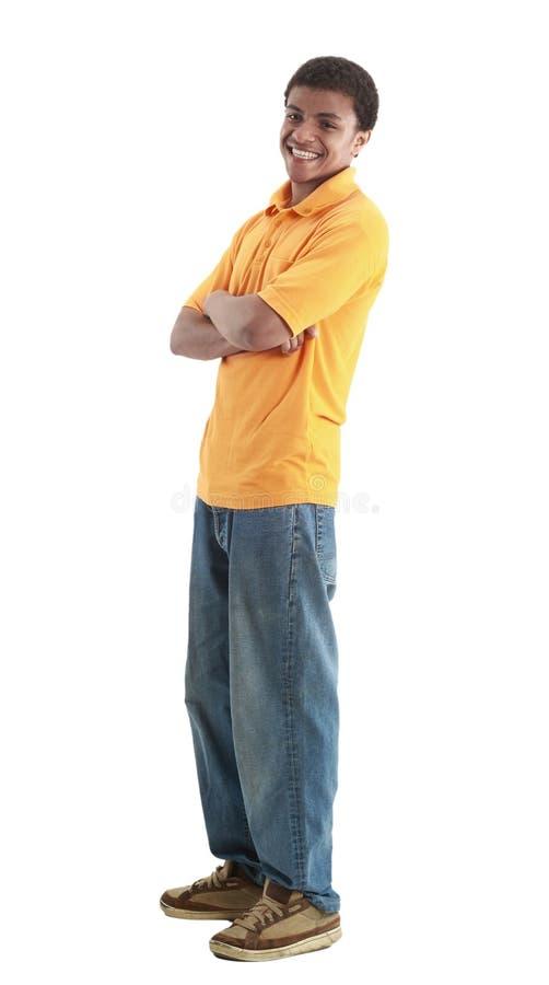 Молодой красивый парень представляя вскользь изолированный на белизне стоковые изображения rf