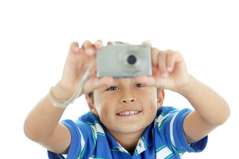 Молодой мальчик с камерой стоковые изображения