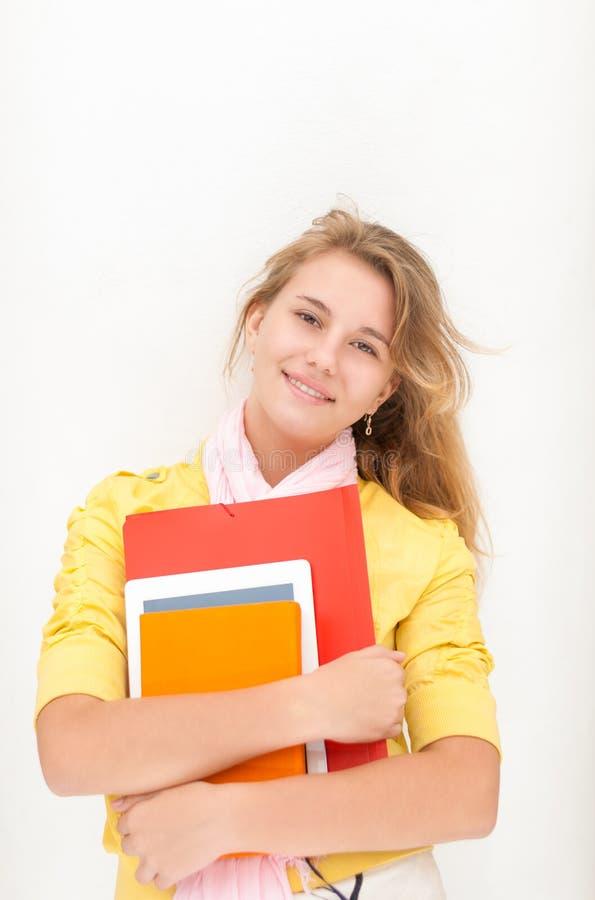 Молодой милый женский студент на белой предпосылке. стоковое фото rf