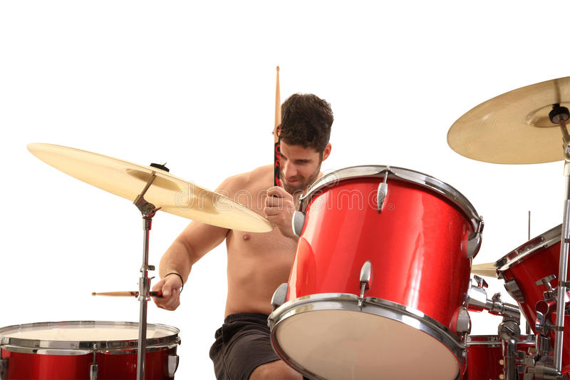 Молодой мыжской барабанщик стоковое фото