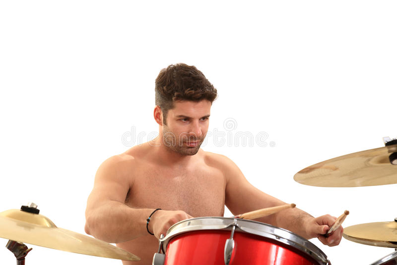Молодой мыжской барабанщик стоковые фото