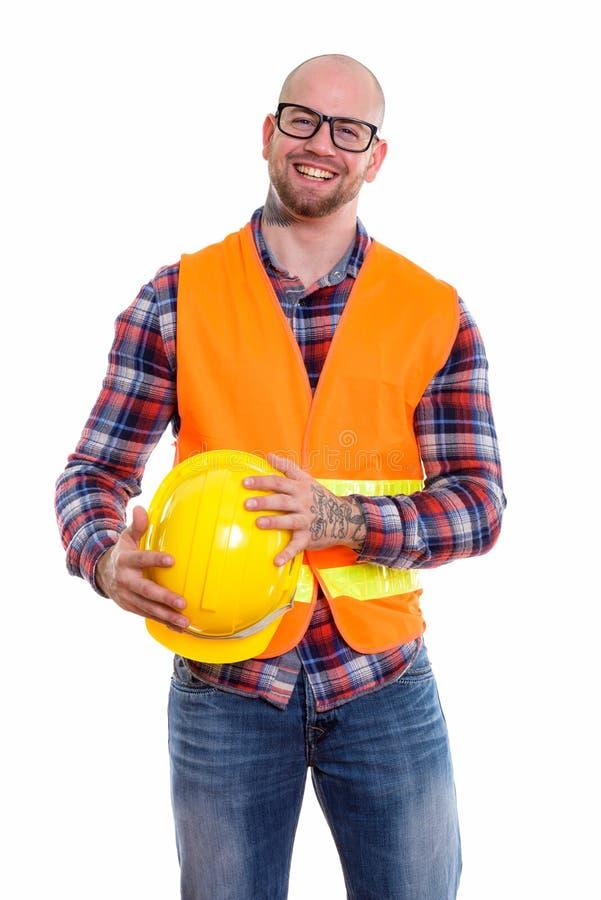 Молодой облыселый мышечный рабочий-строитель человека стоковое изображение rf