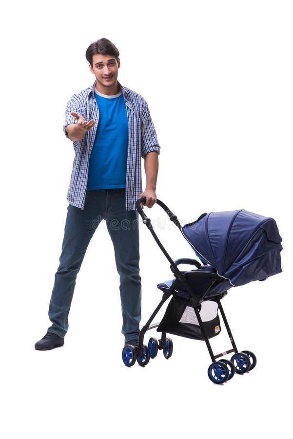 Молодой папа при pram ребенка изолированный на белизне стоковые изображения rf