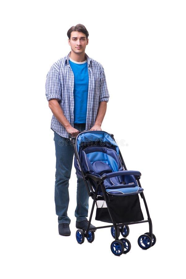 Молодой папа при pram ребенка изолированный на белизне стоковое фото rf