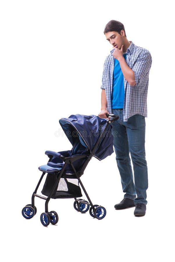 Молодой папа при pram ребенка изолированный на белизне стоковые фотографии rf
