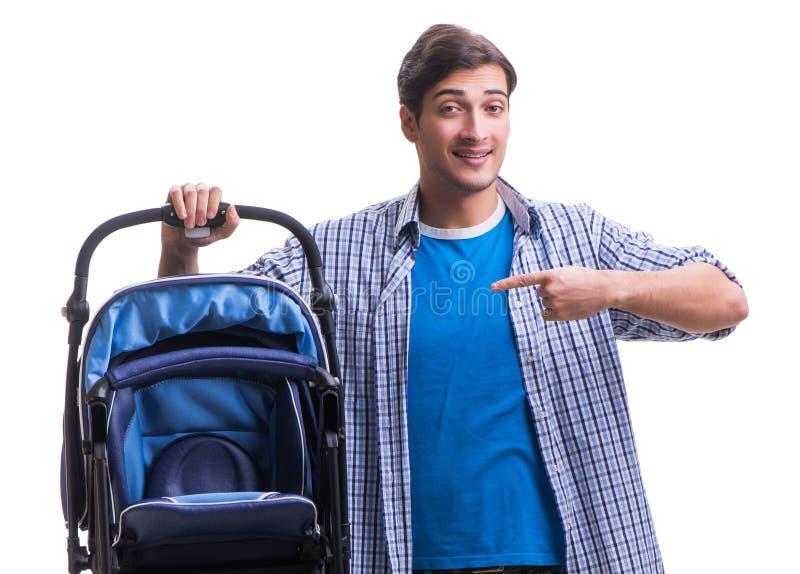 Молодой папа с pram ребенка изолированным на белизне стоковая фотография