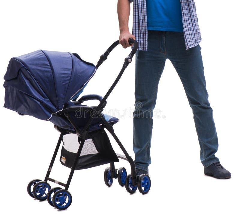 Молодой папа с pram ребенка изолированным на белизне стоковые фотографии rf